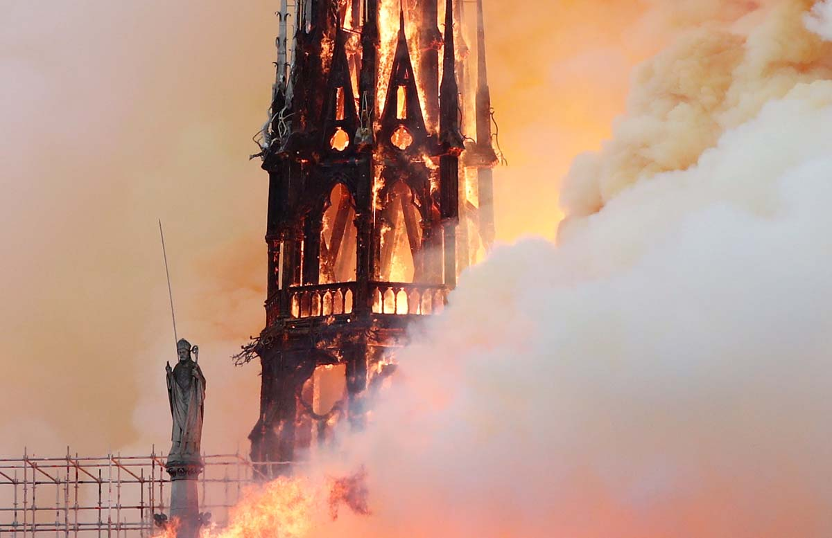 Flames and smoke billow from the Notre Dame Cathedral after a fire broke out in Paris April 15, 2019. Officials said the cause was not clear, but that the fire could be linked to renovation work.